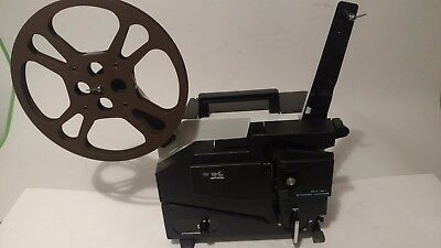 Elmo 16-Cl Optical Movie Projector W/ Sound  Cover And Reel