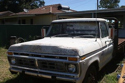 Ford 350 white V8 all steel tray truck tow bar