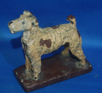 A gorgeous antique Victorian painted plaster wire haired fox terrier dog figure