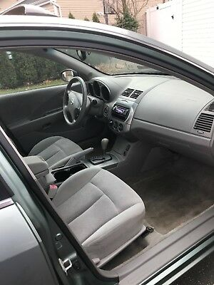 2003 Nissan Altima  afe solid car. Runs great. Clean title.