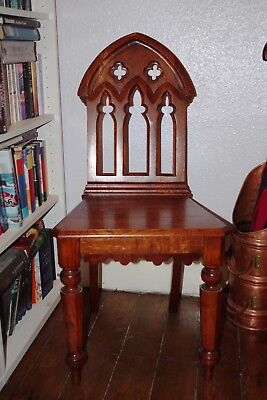 A pair of gothic style chairs