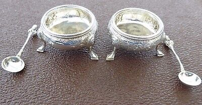 Two silver mustard pots with spoons