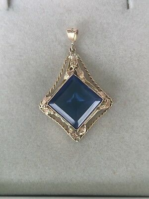 Vintage 9ct Gold Pendant..4 grams..36mm x 23mm..?Sapphire Stone or glass...