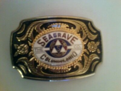 SEAGRAVE COMPANY, COLUMBUS, OHIO - BELT BUCKLE. BLACK & GOLD with SEAGRAVE LOGO