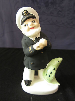 Figurine mid century japanese ship captain and fish for Captain d s country style fish