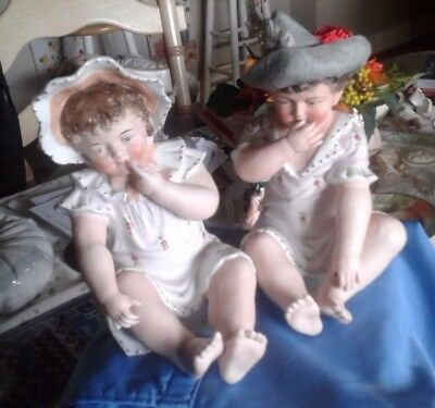 Pair of Antique Porcelain Piano Baby Figurines