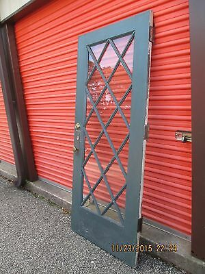 Chestnut Exterior Front Door With Criss Cross On Large Glass
