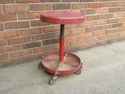 Vintage industrial garage stool made of steel and sturdy wheels
