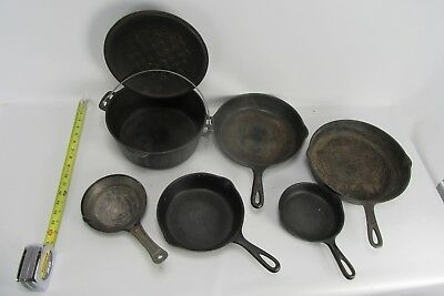 Lot of 6 Assorted Cast Iron Pans & lid, plus one pressed steel sm fry pan.