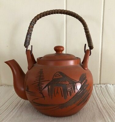 1960s Japanese clay tea pot. Good condition. Three pieces. Wood-wrapped handle.