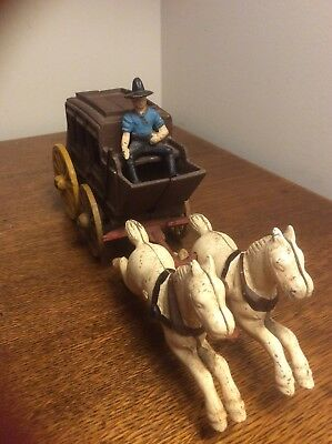 Vintage Cast Iron Stagecoach  with driver and two galloping horses—Toy