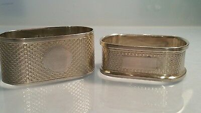 A harlequin pair of two Solid silver napkin rings engine turned decoration