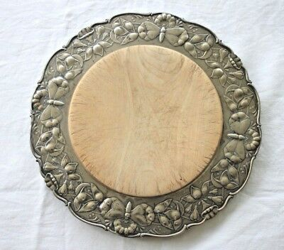 Vintage bread board with decorative embossed metal surround base butterflies