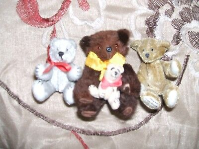 "LOT OF 4 MINIATURE BEARS ranging from 1/2 inch to 1 1/2 "" Artist make/W.Germany"