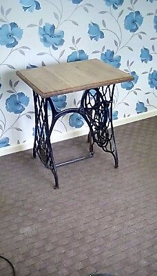 antique singer metal base up cycled with a new solid oak top table/desk