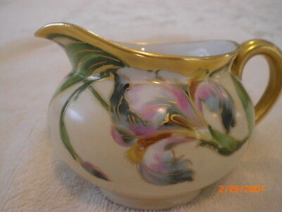 W Wilson hand painted B and C limoges signed iris gold trim creamer