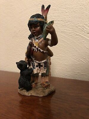 Indian Boy With A Fish And A Bear Cub