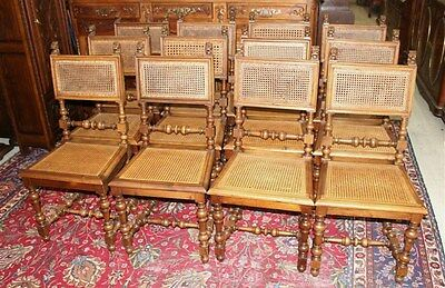 Beautiful Set of 12 French Antique Renaissance Revival Carved Walnut Chairs.