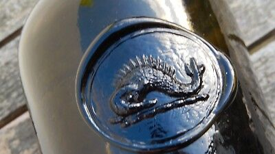 ANTIQUE BLACK GLASS WINE BOTTLE with MOLDED FISH MOTIF SEAL
