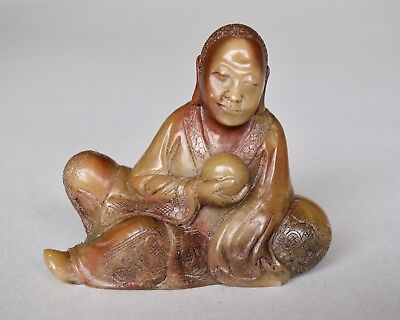 Chinese Carved Soapstone Lohan (Luohan) Reclining and Holding Ball, Qing dynasty