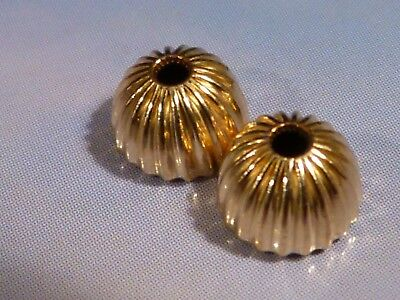 2 CUSTOM 14 KARAT 1/2 ROUND RIBBED GOLD BEADS 6.5 BY 4.4 MM from the pumtekman