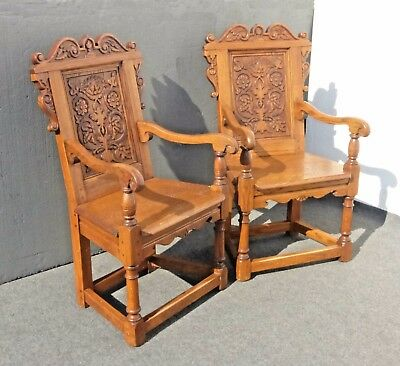 Pair of Vintage Oak Wood Spanish Revival Ornate Carved Arm Chairs
