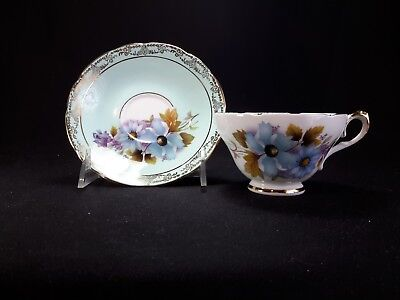 Royal Sutherland Staffordshire Cup & Saucer Blue Flowers on Blue Background