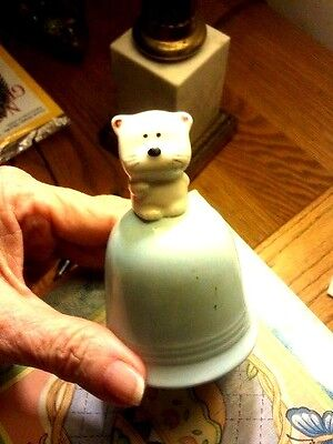 Bell with smiling dog figurine