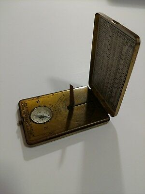 vintage brass sunwatch with compass