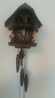 vintage West German musical cuckoo clock needs attention to music box