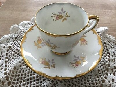 Vintage Royal Chelsea English Bone China cup and saucer rosebud with gold accent
