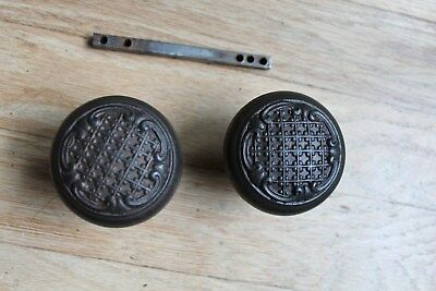 Pair of Victorian Eastlake doorknobs with checked-pattern and spindle.