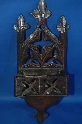 A Victorian carved fretwork gothic style wall rack, for matches, small book etc