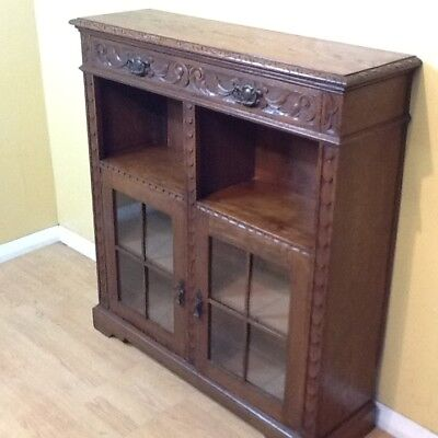 Carved oak Victorian Green man open and enclosed bookcase