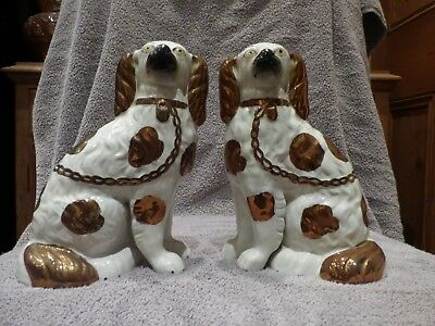 Staffordshire Type Mantle Piece Dogs One Detached  Leg Pair Copper Lustre