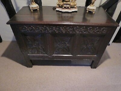 Mid 18th century carved oak coffer