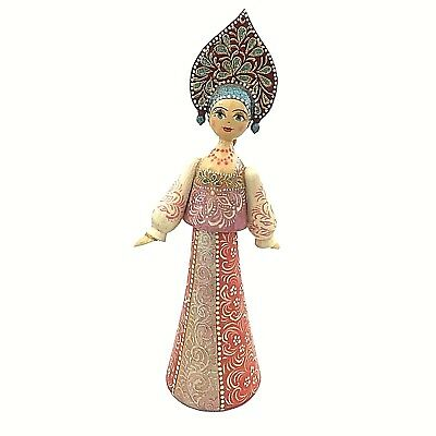 Russian Doll in traditional hat and dress handmade wooden home decoration