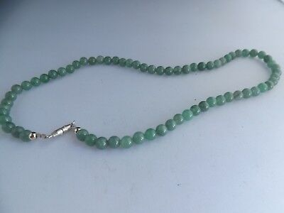 a vintage green stone ball necklace - possibly jade