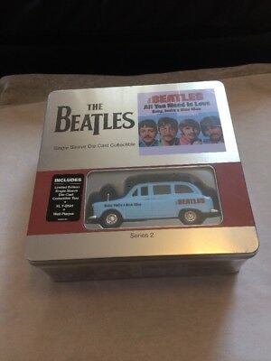 The Beatles Collectible Tin. All You Need Is Love ,taxi,t shirt ,plaque.