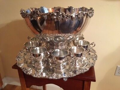 "Birmingham silverplate punch bowl, 21"" tray, and 12 cups. Grapevine motif."