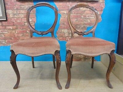 pair of victorian walnut antique carved cabriole legs balloon back chairs.