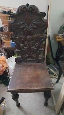 Antique dark oak carved single chair
