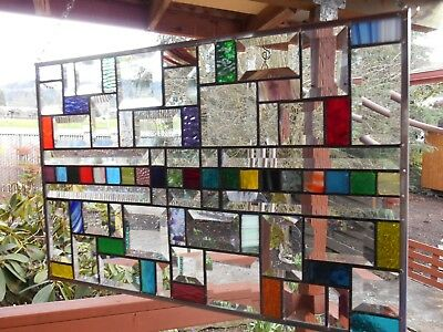 Mutli colored stained glass window panel with bevels
