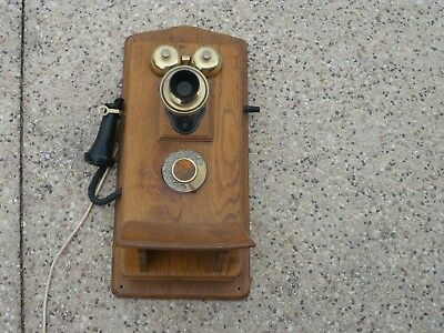vintage style old fashioned type timber wall phone