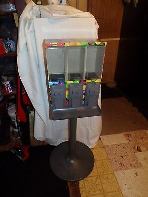 """""""Multivend"""" triple candy/gum machine, on stand"""