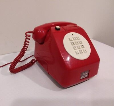 vintage red coin operated pay phone telephone