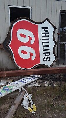 Phillips 66 porcelain sign with bracket and pole.