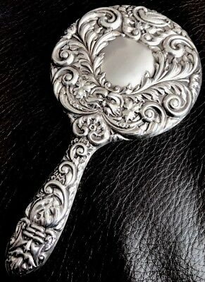 solid silver hand held mirror with b and co anchor lion and letter W on it