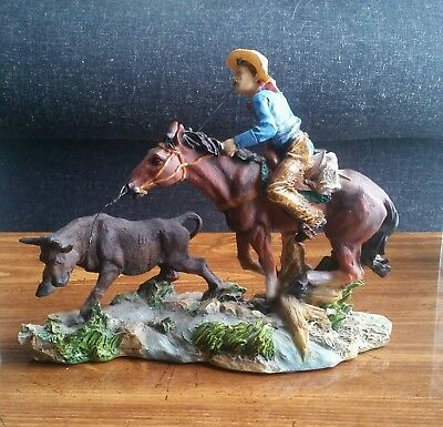 Western Cowboy and Bull figurine