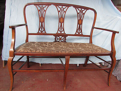 Edwardian mahogany upholstered inlaid two seater settee with turned legs.